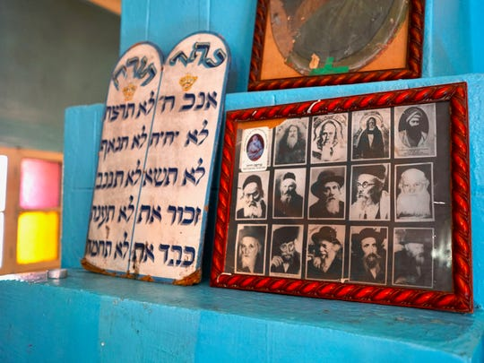The shrine of Shalom bel Hensh, a Jewish Moroccan saint; the Hebrew inscription on the left is the Ten Commandments; on the right are photos of other important Moroccan Jewish scholars.