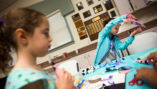 Emma Woob, 7, pretends to fly her handmade rocket during a hands on workshop for young girls on Saturday, September 2, 2017 at the Naples Girl Scout House in Cambier Park. Emily Hugan, 17, is working for her Gold Award in troop 477 with her project, Sisters in Strength.