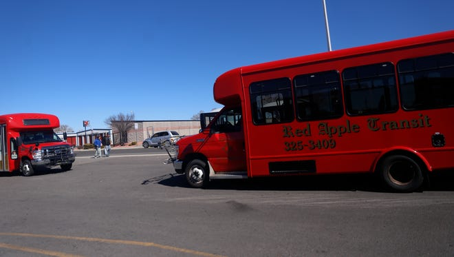 A Red Apple Transit bus waits for passengers on Friday at Orchard Plaza in Farmington.