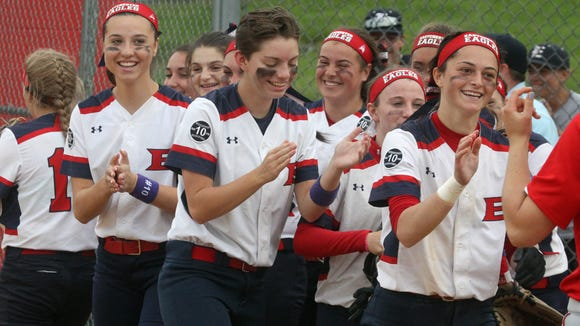 Eastchester players celebrate their 3-2 win in a Section