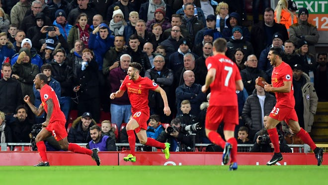 Liverpool's Georginio Wijnaldum, left, celebrates scoring his side's only goal against Manchester City.