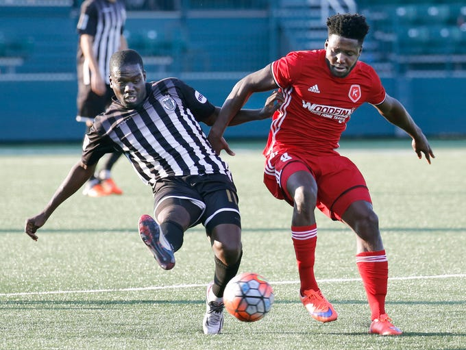 Rochester Rhinos' Kenardo Forbes reaches for the ball