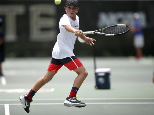 Chris Cadernas, 11, plays a match during the Seminole High Performance tennis camp last Thursday at the Speicher Tennis Complex.
