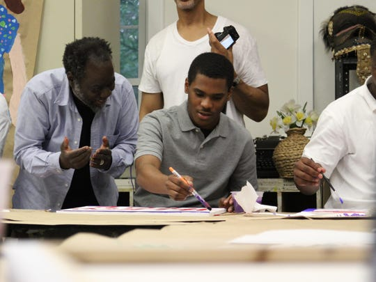 Ouattara Watts, left, instructs 17-year-old Robert on Wednesday at the Rye Arts Center.