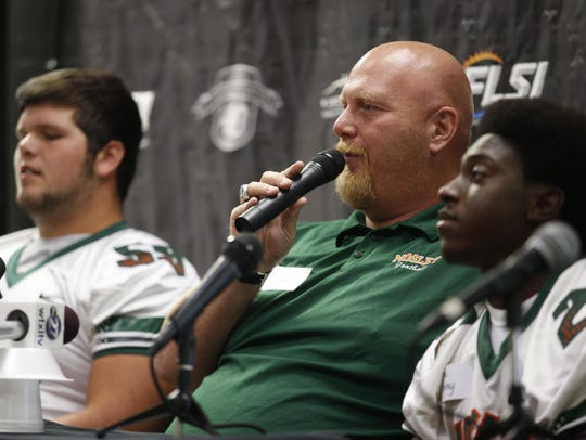 Mosley football coach Jeremy Brown answers questions