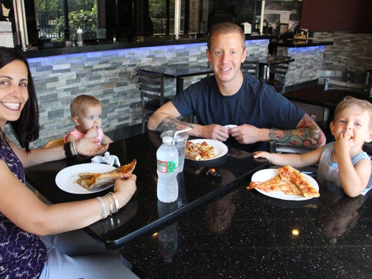 Anna and Travis Plenderleith eat at The Godfather two or three times a week with their children, Kadence, 11 months, and Damian, 3.