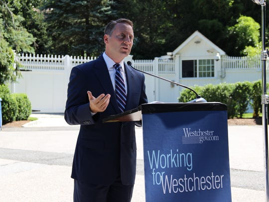 Westchester County Executive Rob Astorino discusses his concerns about  the affordable housing settlement at a July 24 press conference outside Bill and Hillary Clinton's Chappaqua home.
