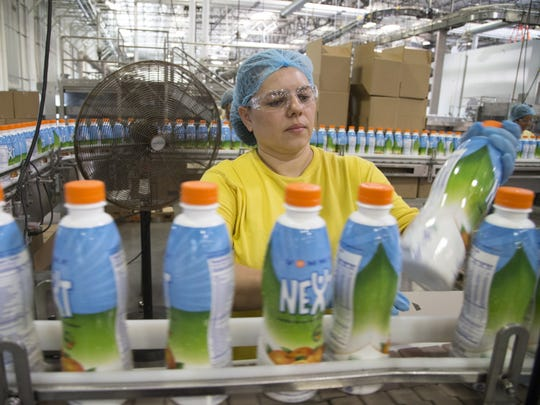 Norma Santiago works on the packaging line for Vemma