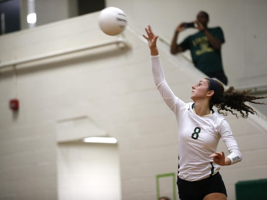 Lincoln junior Madison Fitzpatrick serves during the