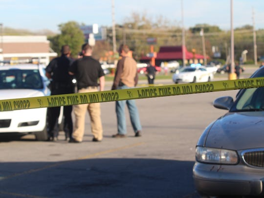 Clarksville Police discuss a shooting on Fort Campbell Boulevard Tuesday afternoon next to a vehicle found with blood droplets on the hood.