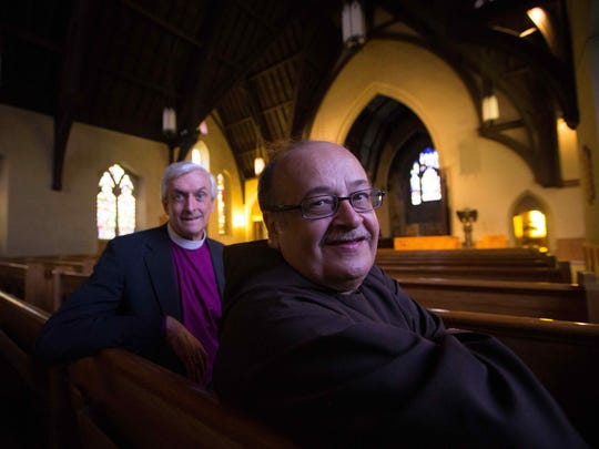 "Shown in the Cathedral Church of St. John sanctuary, which would be used as a gathering space for reading, playing cards and other group activities, the Right Rev. Wayne P. Wright, left, said Brother Ronald Giannone, right, offered ""the right plan"" to reuse the long-vacant church and his Ministry of Caring has the track record to make the plan a reality."