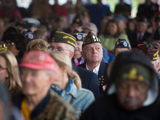 Hundreds attend the annual Veterans Day service at the Memorial Plaza at Delaware Memorial Bridge. The National Veterans Day Committee in Washington, DC has designated Veterans Day in New Castle, DE, as a National Veterans Day Regional Site for our nation's annual Veterans Day celebration.