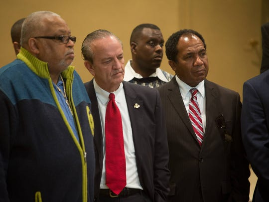 """County Executive Tom Gordon and Mayor Dennis Williams attend a gathering of local clergies and community leaders at Congregation Beth Emeth as they denounce the title of """"Murder Town USA""""."""