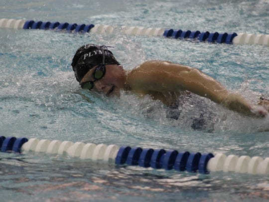 Competing during a recent race for the Plymouth Wildcats is senior Allison Lennig. She will swim in four events at the D1 state finals in Holland.