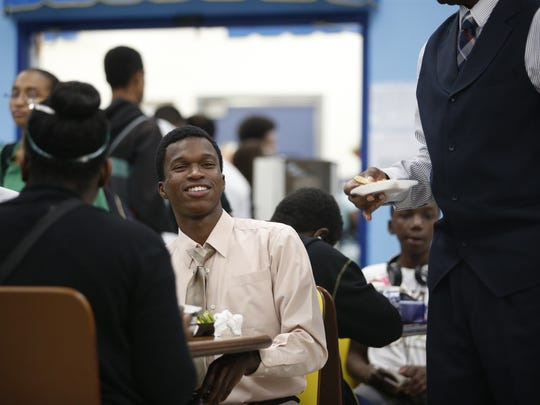 Senior Delawn White eats lunch on 'Gentlemen's Day' at Rickards High School, Wednesday, Nov. 18. The day was an idea of Coach Ewell Carter, who started it as a once-monthly event and is hoping to spread the idea throughout the state, and eventually the country by the end of the school year.