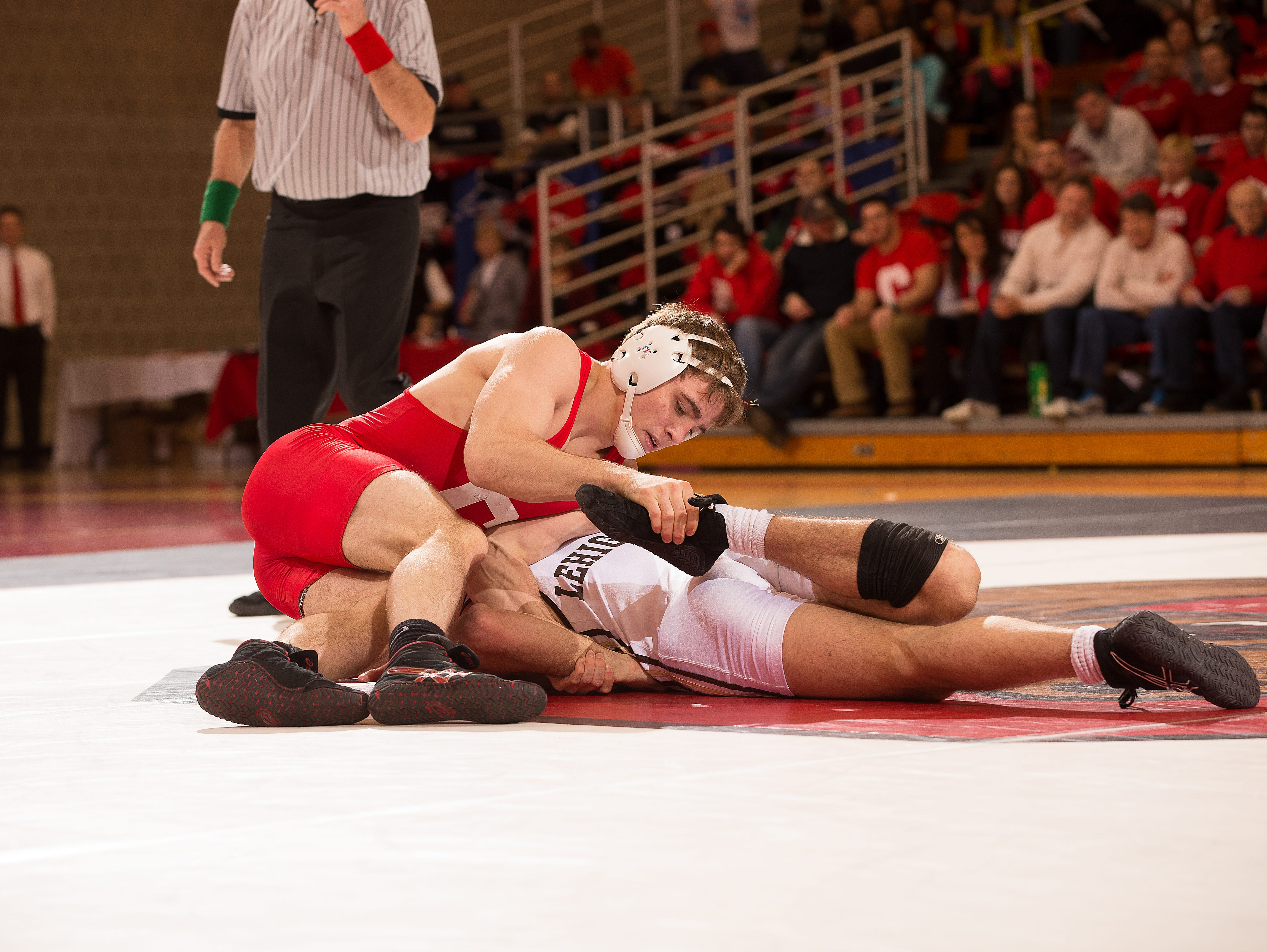 Cornell junior and Somers graduate Brian Realbuto (top) is set to compete in the NCAA Division I wrestling championships at Madison Square Garden on March 17-19.