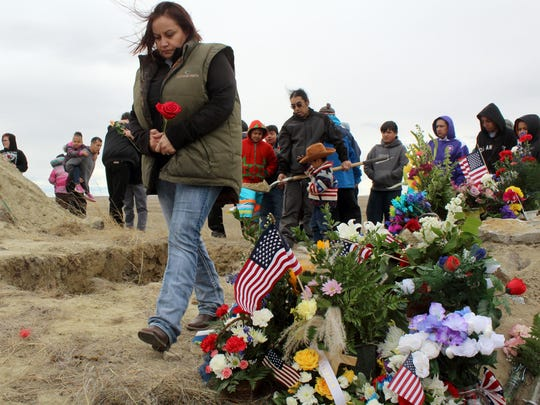 Donette Stiffarm pays her respects to her grandfather Gilbert Horn Sr. during funeral services for the decorated veteran and tribal statesman Wednesday near Fort Belknap Agency.