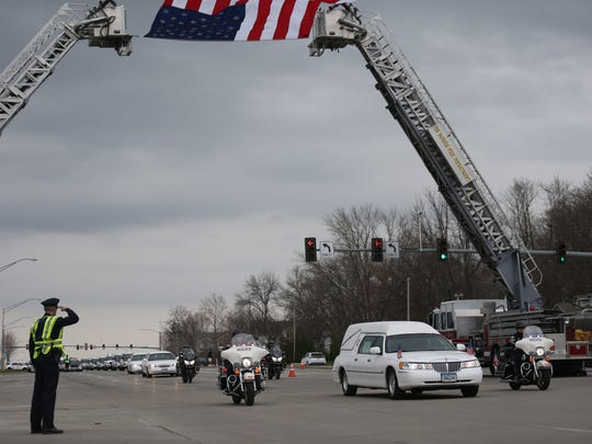 The hearse and funeral procession begin for Officer Susan Farrell, 30, at Lutheran Church of Hope in West Des Moines on Wednesday, March 29, 2016. Farrell was one of the officers killed in a car crash early Saturday morning on Interstate 80.