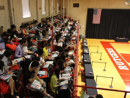 Rutgers students attend an orientation in August 2013