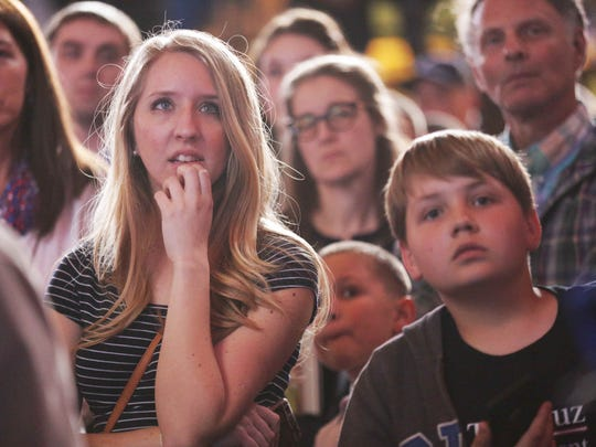 Ted Cruz supporters Alyssa Sander (center left) and Gavin Ellis (right) watched Bernie Sanders' speech on CNN during a Cruz election night party May 3, 2016, at Union Station in Downtown Indianapolis.