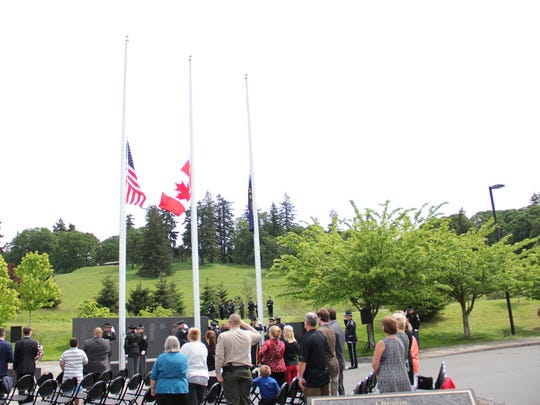 Flags fly half-staff  at the Oregon Fallen Law Enforcement Officers' Memorial Ceremony on Tuesday, May 3, 2016.