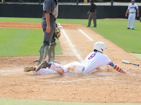 Louisiana Tech third baseman Chase Lunceford slides in safely to home plate in Thursday's win over Charlotte. Lunceford hit his 10th home run of the year.
