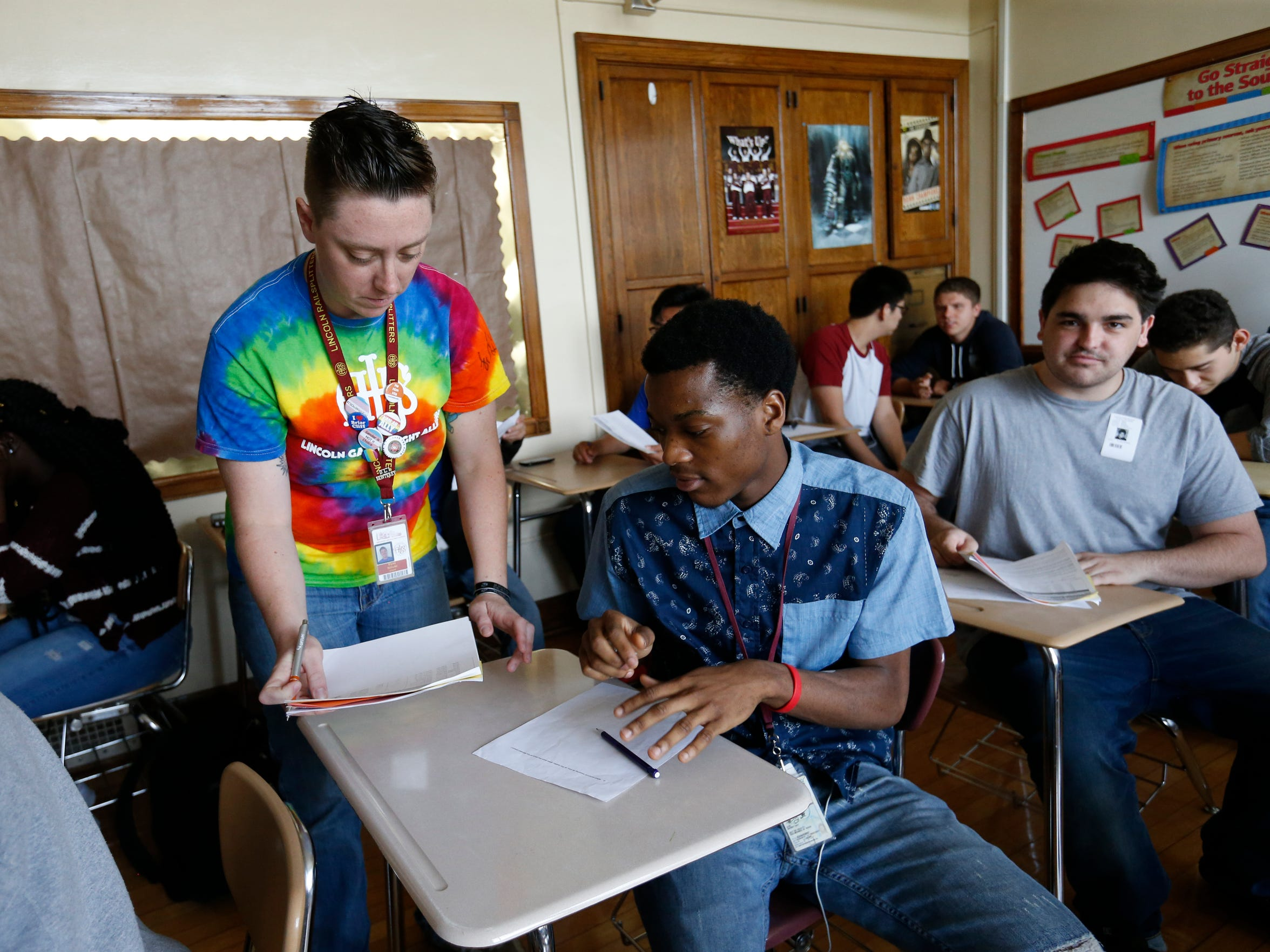 Jack Schuler signs off on work from his students Friday, May 20, 2016, at Lincoln High School in Des Moines.