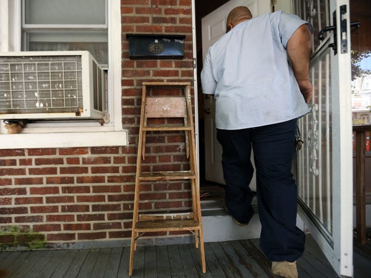 Bruce Jarvis, who completes repairs for properties owned by Wilmington Housing Authority, works at a house on Wednesday. The Wilmington City Council may require training for those who oversee rental properties.