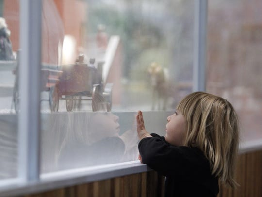 Sofie Wild, 3, Alpine, Texas, takes a look at the Alexander