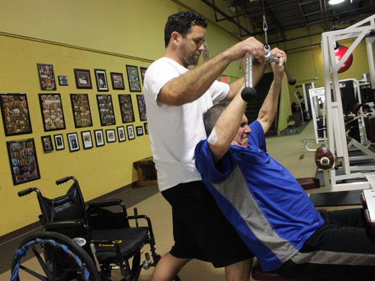 Brandon Blair, personal trainer and one of the owners of 180 Fitness in Statesboro, Georgia, works with Bob Henshaw, 57, the youngest resident of Eagle Rehabilitation facility who suffered a broken neck and paralysis after a biking accident while training for a triathalon. The two work out three times a week to help Henshaw gain strength and better range of motion.
