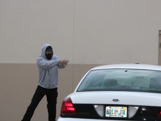 Punta Gorda police officer Lee Coel fires his gun during