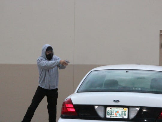 Punta Gorda police officer Lee Coel fires his gun during