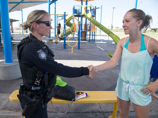 Peoria Police officer Julie Smith talks to Shelby Galles during a recent park patrol.