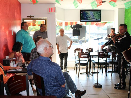 The mariachi band Mariachi Nuevo Mexico of New Jersey performs for those gathered for T-Bone Taco's ribbon cutting.