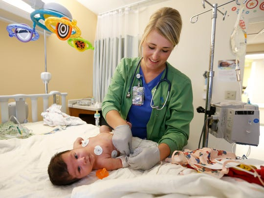 Registered nurse Amanda Ponder works with 3-month-old Gideon Sams, who is recovering from surgery at Mercy Hospital on Wednesday, Aug. 31, 2016.
