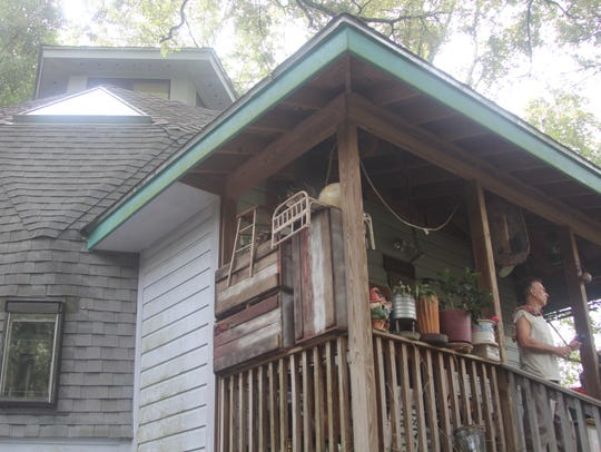 Larry Bosco stands on the porch of his dome house in