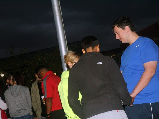 Harding High School students met at the school flagpole on Wednesday to pray.