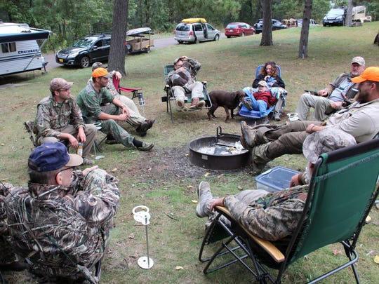Duck hunters gather for a noon break at their campsite near Grantsburg on Sept. 24, opening day of the 2016 Wisconsin waterfowl hunting season.