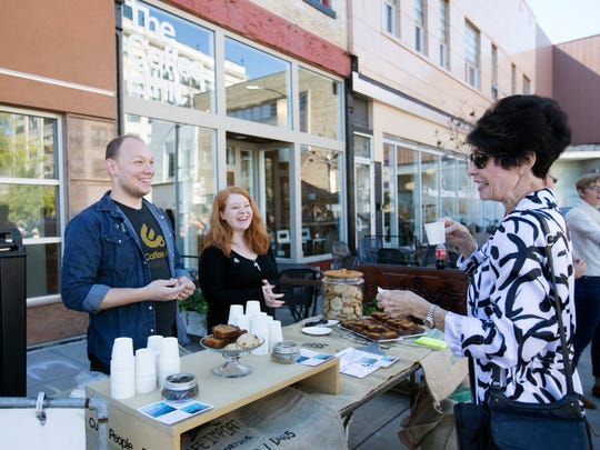 Shanelle Long, of Branson, right, talks with Nate and Kara Murphy in front of The Coffee Ethic at the Taste of SOMO last October.