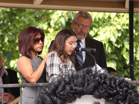 Lt. Cowles' daughter Arianna Cowles-Reyes fights through tears to deliver memories of her father during Friday's memorial services.