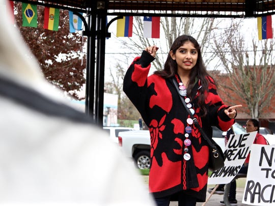 Marisol Ceballos, Academy of International Studies student at Woodburn High School, tells a group of 100 high school students her fears of deportation of her undocumented family members under a Donald Trump presidency on Friday, Nov. 11 at Downtown Woodburn Plaza.