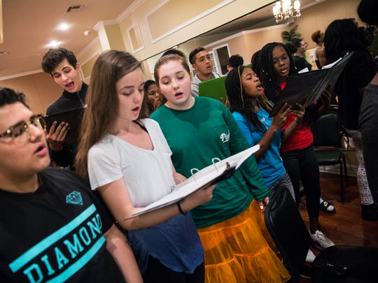 "Shirley Vilsaint, 16, second from right, sings with the ensemble during rehearsal for ""Hairspray"" at the Naples Performing Arts Center in Naples on Sunday, Nov. 13, 2016. ""I was a little girl, and I saw 'High School Musical,' and I was like, 'Oh my gosh, I can't wait for high school!' And then reality sunk in,"" Vilsaint said. ""But I'm praying that I don't have to be a lawyer so I can be in the performing arts, because that's really where my heart's at."""