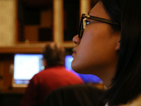 Anh Dang Minh Vu, a composition and theory major, listens to Oliver Schneller, professor of composition, teach in the Eastman Audio Research Studio.