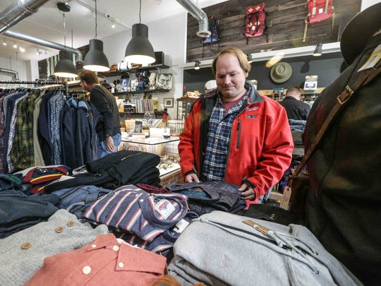 Blaine Posey shops at James Dant, a store for men, 5624 E. Washington St., during Small Business Saturday on Nov. 26, 2016.