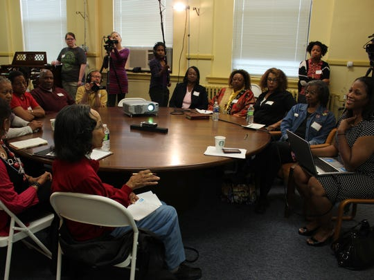 "Dr. Amy Tillerson-Brown, associate professor of history at Mary Baldwin University, sits far right with her laptop while conducting interviews for the documentary, ""Threads of History: Conversations with a Community"" in 2013. Round table discussion includes Booker T. Washington High School alumni, community members and teachers."