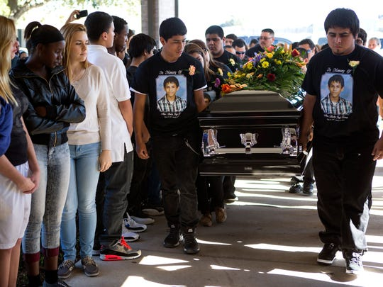Andrew Mitchell/Caller-TimesFriends and classmates stand as Alex Samuel Torres is carried in his coffin by his family and friends Tuesday afternoon, January 20, in Corpus Christi. 01/20/15