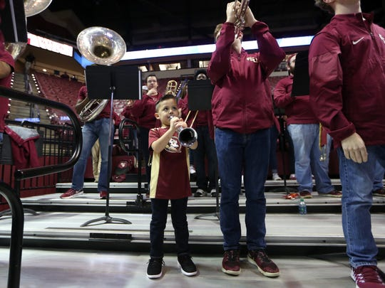 DJ Read, 4, performs on his toy trumpet with the Seminole Sound during the women's basketball game against Wake Forest at the Tucker Civic Center on Thursday, Feb. 9, 2017.