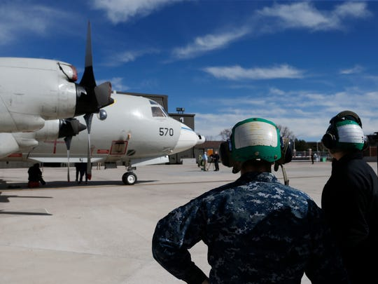 In this Feb. 17, 2017 photo, military ground crew attend to a Navy P-3 Orion aircraft used for a NASA-led experiment called SnowEx, on an airfield at Peterson Air Force Base in Colorado Springs, Colo. Airplanes are scanning the Colorado high country with an array of sensors as scientists search for better ways to measure how much water is locked up in the world's mountain snows.
