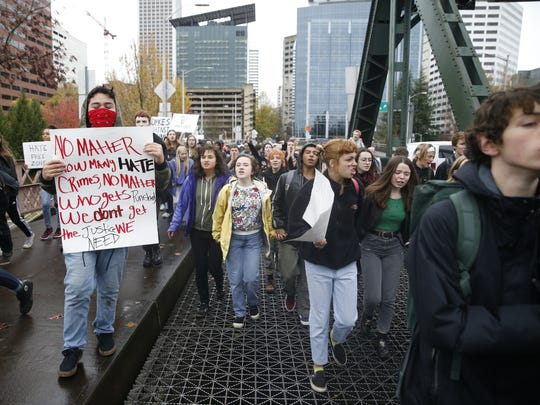Portland Public School students walk out of schools and converge on Pioneer Courthouse Square for a protest against the results of last week's presidential election.
