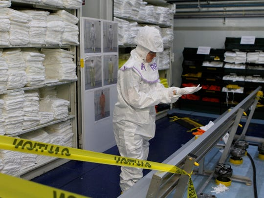 Serina Snyder, a radiation protection technician, is monitoring radiation levels that may expose workers while maintenance work is being done at Indian Point 3 at the Entergy Indian Point Energy Center in Buchanan on March 20, 2017.